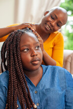 Mother Braiding Hair For Daughter