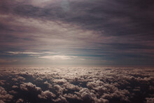 Sunlight Between Layers Of Thick Clouds In The Sky - View From An Airplane - Heaven Concept