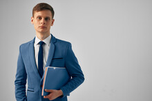 Man In A Suit With A Blue Folder In His Hands Work Office Official