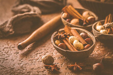 Assortment Of Different Spices And Nuts For Christmas Baking In Warm Brown Tone