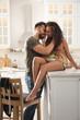 Leinwandbild Motiv Lovely couple enjoying time together in kitchen at home