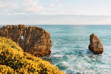 Rocky Coast Of Sea In Sunny Day