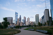Chicago City Skyline From Maggie Daley Park, With Metal Pedestrian Bridge In Front