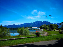 Beautiful Landscape View On The Coast Of The Lake With Mountain In The Background Under A Blue Sky