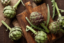 Fresh Green Artichokes Cooking On Wooden Background