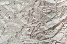 Crumpled Silver Aluminum Foil As Background