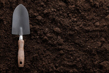 Garden Trowel On Soil Background, Close Up View