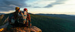 The couple meets the sunset in the mountains. Two travelers are sitting on the edge of a cliff and admiring the beautiful panoramic view. Travelers with backpacks at sunset in the mountains. Panorama