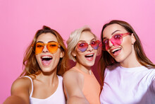 Self Portrait Of Three Funny, Funky, Emotional, Expressive, Pretty Girls, Gesture Posing On Pink Background, Celebrating Birthday, Women's Day, Spring