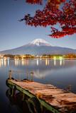 Fototapeta Nowy Jork - Mount Fuji seen from Lake Kawaguchiko at night, Yamanashi Prefecture, Japan