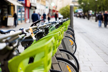 Selective Focus Of A Line Of Parked Bicycles In France