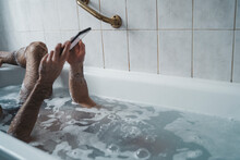 Close Up Man Holding The Phone With His Head Underwater