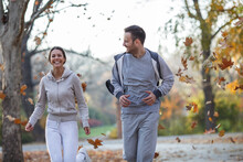 Young Couple Jogging At City Park