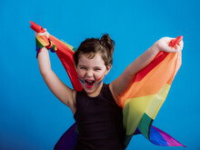 Cheerful Girl Holding Multicolored Flag