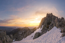 Landscape Of Snowy Mountains At Sunset