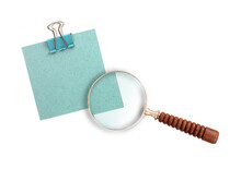 Sheet Of Paper With Binder Clips Isolated On A Gray Background