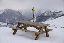 Ski Resort In The Mountains Alps France Picnic Table And Cliff Sign Warning