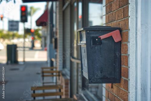 Obraz na plátně Mail box on the side of a building.
