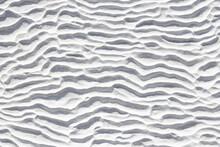 White Texture Of Pamukkale Calcium Travertine In Turkey, Pattern Of Horizontal Waves, Close-up.