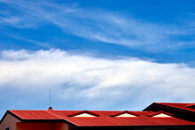 The Fluffy Clouds With  Blue Sky Over The Roof Top