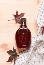 Beautiful Canadian Maple Syrup In A Bottle On A Light Wooden Background. Pancakes With Syrup Or Honey.