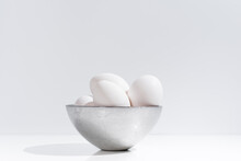 White Chicken Eggs In Bowl On Table