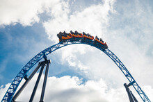 Ride Roller Coaster In Motion In Amusement Park