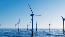 Wind Power. Offshore Wind Turbines On A Clear Evening. Environmental Power Concept.