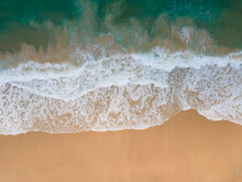 (Top View) Aerial View Drone Over Beach Sea. Beautiful Sea Waves. Beach Sand And Amazing Sea. Summer Sunset Seascape. Phuket Thailand Beach. Water Texture. Top View Of The Fantastic Natural Sunsets