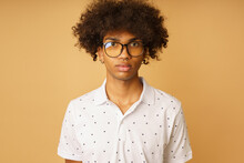 Serious Afro Man With Glasses And Piercing