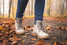 Walking With Hiking Boots On Road At Autumn Woodland
