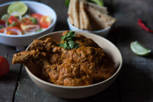 North Indian Delicacy Murg Makhani Or Butter Chicken Prepared With Chicken Breast, Onion, Garlic And Whole Indian Spices In A Bowl. Close Up.