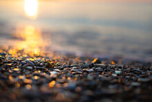 Golden Bokeh From The Sun's Ray On The Stones