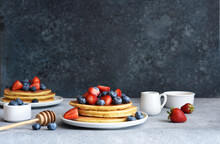 Homemade Pancakes With Strawberries And Blueberries For Breakfast On The Kitchen Table.