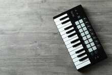 Midi Keyboard On Gray Textured Background, Space For Text