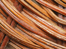 Abstract Image, Background, Texture, Closeup. Wicker Basket. Curved Orange And Dark Red Vine