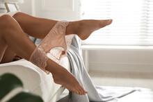 Woman Wearing Pink Sexy Panties On Sofa At Home, Closeup