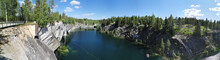 Panoramic View Of The Picturesque Rocky Shores And Turquoise Waters Of The Marble Canyon In The Ruskeala Mountain Park On A Sunny Summer Day.