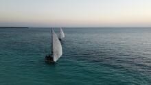 Two Traditional African Sailboats Observing Sunset In Nengwa, Zanzibar