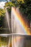 Fototapeta Tęcza - Rainbow over the fountain.