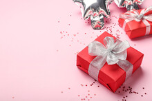 Gift Box And Confetti On Color Background