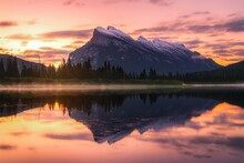 Orange Sunrise Sky Glowing Over Mountains At Vermilion Lakes