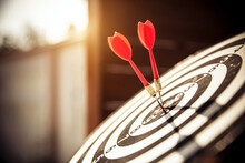 Bullseye Or Bulls Eye Target Or Dartboard Has Red Dart Arrow Throw Hitting The Center Of A Shooting For Financial Business Targeting Planning And Aim To Winner Goal Of Business Concept.