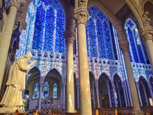 Beautiful Interior Of The Basilica Of Pontmain, Northern France. Blue Stained Glass Windows