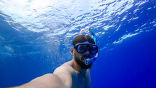 A Man In Breathing Tubes And Masks Plunges To The Bottom Of The Red Sea A Bearded Man Is Engaged In Snorkeling