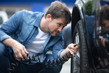 Male Motorist Inflating His Car Tyre