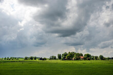 Zwolle, The Netherlands, August 10, 2021: Dramatic Skies And Spectacular Lighting Conditions Over The Polder Landscape Along The IJssel River