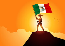Mexican Man In Sombrero And Traditional Costume Holding The Flag Of Mexico On Mountain Peak