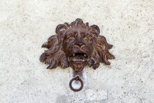 Rusty Lion Head With Iron Ring That Was Used To Tie Horses On Wall