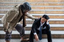 Homeless Man Encourage Depress Businessman